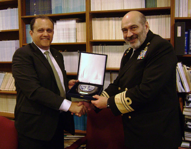 Vice Admiral Christidis giving Nick Larigakis a commemorative Greek Naval Insignia Plaque on behalf of the Hellenic Navy.